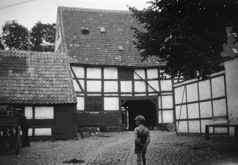 Boy in courtyard, Ystad, Skåne, Sweden